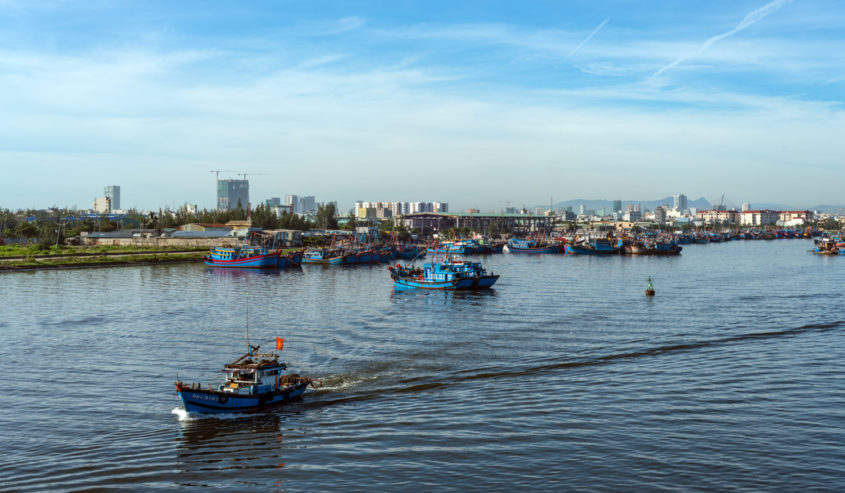 A small fishing boat heads into Da Nang Bay; fishing is important to the local economy in Da Nang