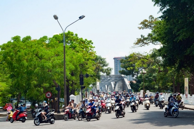 Few Vietnamese own private cars; for most people motorbikes are the primary form of personal transport.