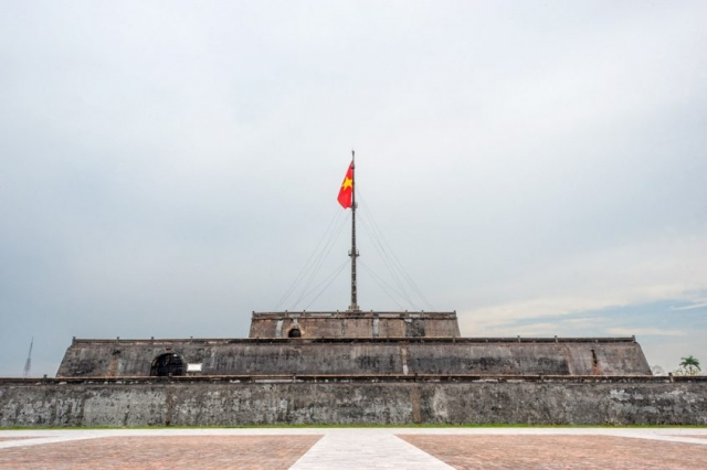 The Flag Tower, completed in 1807, stands across from the Meridian Gate to the Imperial Citadel in Hue, Vietnam.
