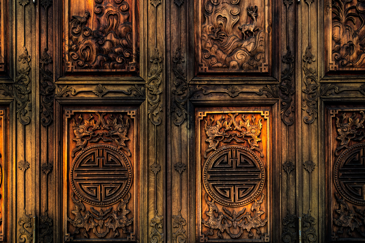 This elegant wooden doorway graces the residence of the Roman Catholic Archbishop of Hue.