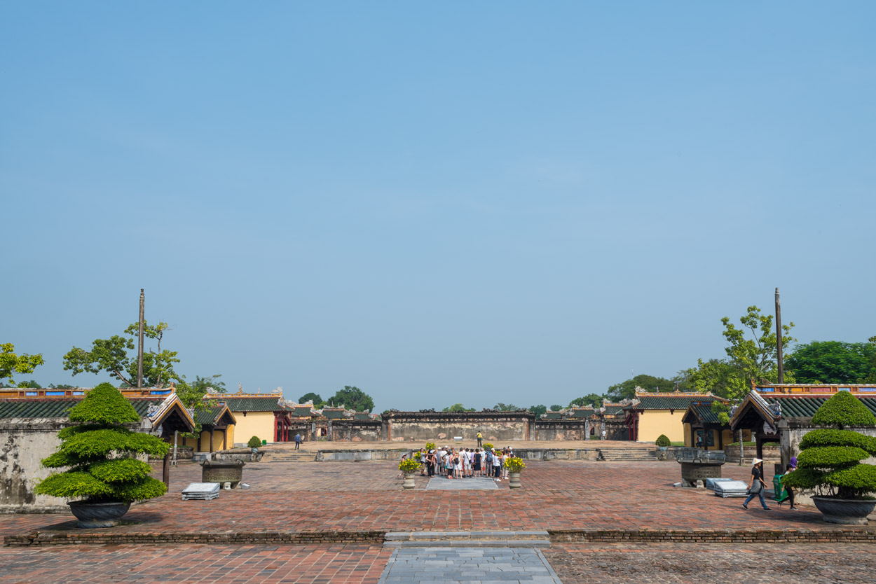A tour group begins its walk through the Purple Forbidden City in Hue.